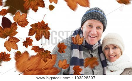 Mature winter couple against autumn leaves