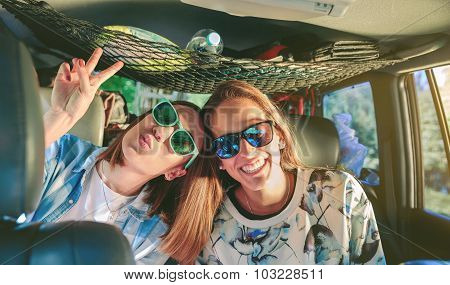 Happy women laughing and having fun inside of car