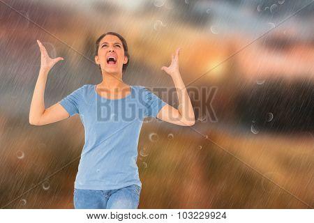 Annoyed brunette gesturing against country scene