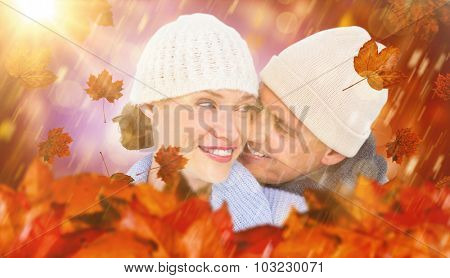 Casual couple in warm clothing against dark abstract light spot design