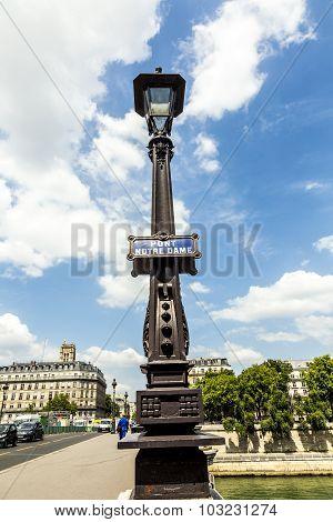 Lantern At Bridge With Sign  Pont Notre Dame