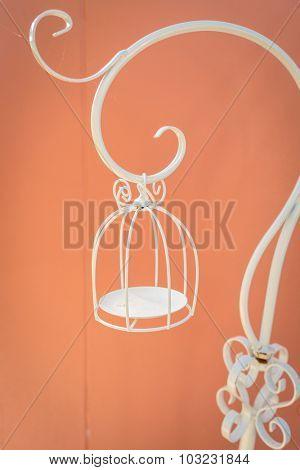 Empty white bird cage