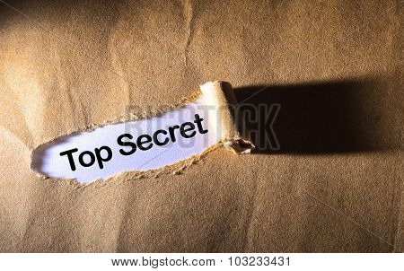 Torn Paper With Word Top Secret