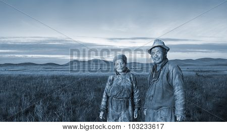 Mongolian Couple Farmers Holding Basin Posing Field Concept