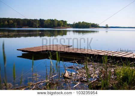 Pier For  Fishing Boats On Shore Of Lake