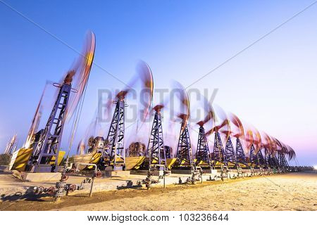 oil pumps working at oilfiled at dusk
