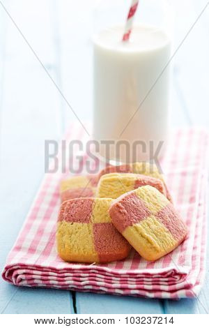 colored butter biscuits on pink napkin