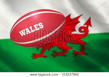 Wales rugby ball against flag of wales