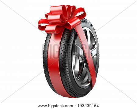 Tyre With A Wrapped Red Ribbon And Bow.