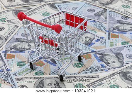 Shopping Cart On Dollars Banknotes