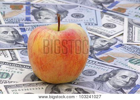 Close Up Of Apple On Money