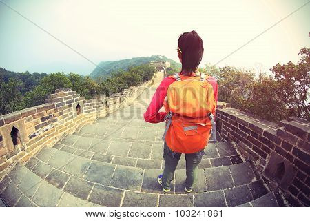 woman hiker hiking on chinese great wall