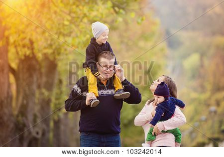 Happy family in a city park