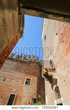 VERONA, ITALY - SEPTEMBER 2014 : A Balcony and parts of old brick Castle Fortress (Castelvecchio) in Verona, northern Italy on September 14, 2014. Castelvecchio was built during Middle Ages.