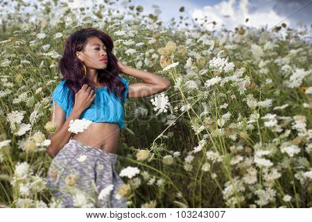 Young beautiful African American girl enjoys summer day.
