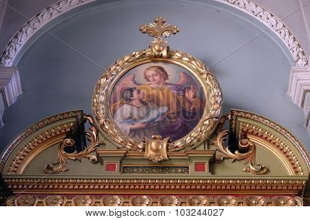 ZAGREB, CROATIA - MAY 28: Guardian angel, altarpiece in the Basilica of the Sacred Heart of Jesus in Zagreb, Croatia on May 28, 2015