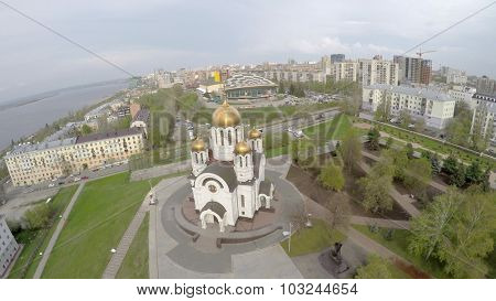 SAMARA - MAY 05, 2015: Cityscape with church of St. George on Glory Square at spring cloudy day. Aerial view video frame
