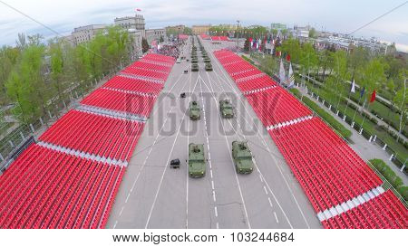 SAMARA - MAY 06, 2015: Military hardware moves along empty tribunes at spring evening. Aerial view video frame