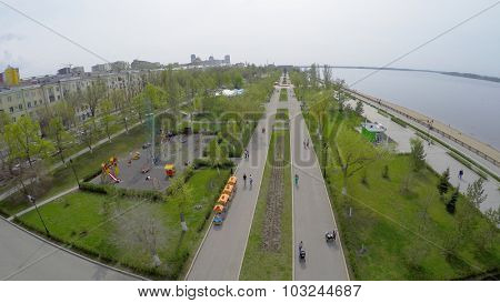 SAMARA - MAY 05, 2015: Public garden on quay of Volga river at spring sunny day. Aerial view video frame