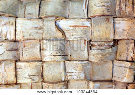 The texture of woven birch bark
