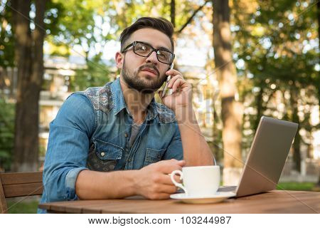 Freelancer hipster man speaking over mobile phone
