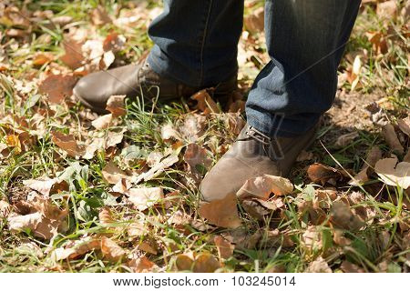 Man's legs in autumn season