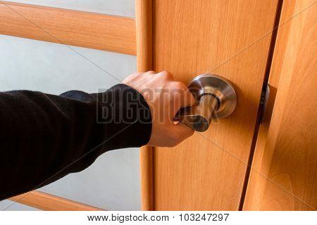 Man Opened The Wooden Door