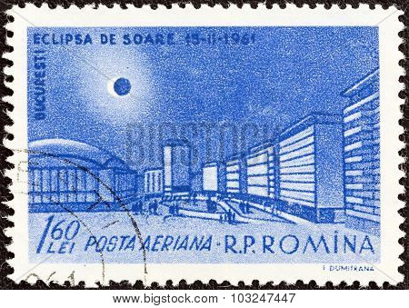 ROMANIA - CIRCA 1961: A stamp printed in Romania shows Eclipse over Palace Square, Bucharest