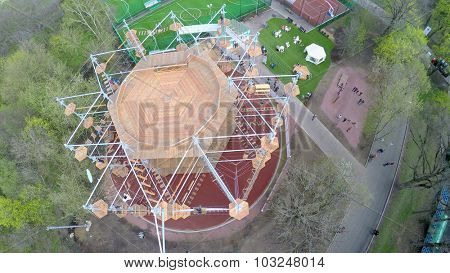 MOSCOW - MAY 04, 2015: People walk by alleys near Tall Rope Park Skytown in VDNH at spring cloudy day. Aerial view video frame
