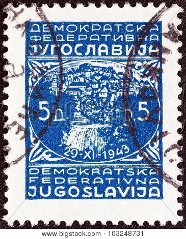 YUGOSLAVIA - CIRCA 1945: Stamp shows town of Jajce and inscription 29-XI-1943