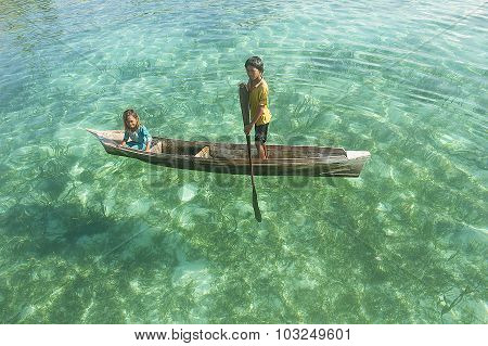 Sabah, Malaysia-may 25, 2014:unidentified Borneo Sea Gypsy Kids On A Canoes  In Mabul Maiga Island,