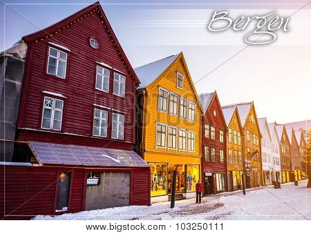 postcard with Famous Bryggen street with wooden colored houses in Bergen at Christmas, Norway