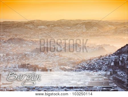 postcard with view of winter city with fog  from the mountain top