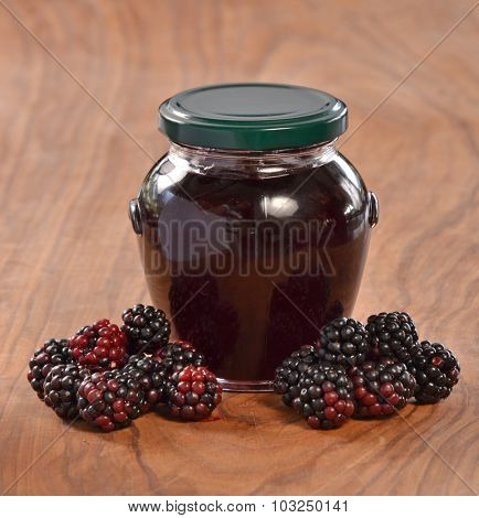 Blackberry jam glass container and fruits. Jam jar.