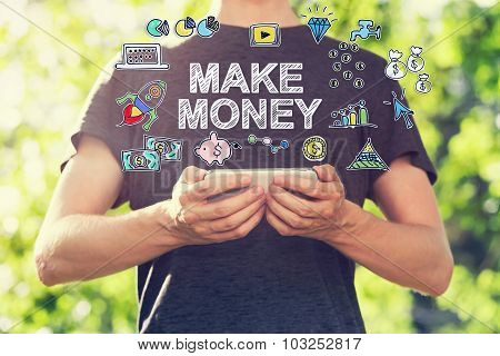 Make Money Concept With Young Man Holding His Smartphone