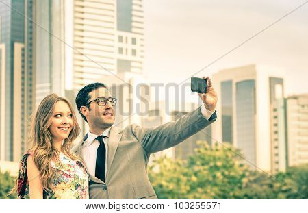 Modern Couple Taking A Selfie At Business Center Outdoors - Concept Of Love And Tech Interaction
