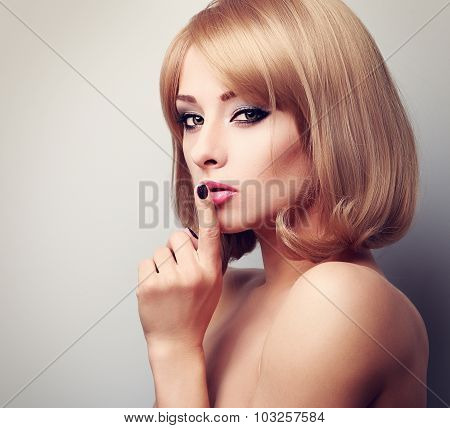 Beautiful Makeup Blonde Famale Model Showing Secret Sign And Looking Sexy. Closeup
