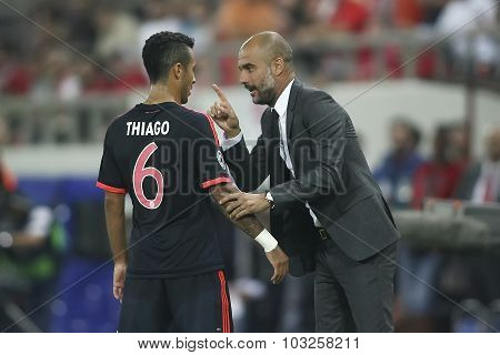 Coach Josep Guardiola (r) Of Bayern Munchen Coaches Thiago Alcantara (l) During The Uefa Champions L