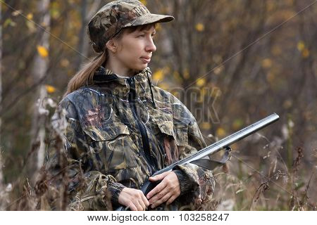 Woman Hunter With Gun In Autumn Forest