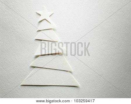 Cristmas tree paper cutting design card.White background