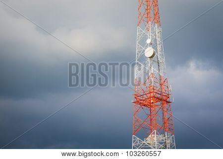 Telecommunication Tower And Rainy Dark Cloudy Sky With Copyspace On The Left