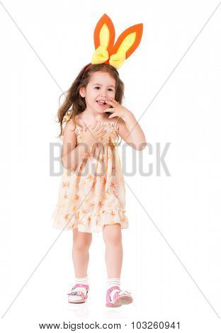 Happy little girl with bunny ears over white background.
