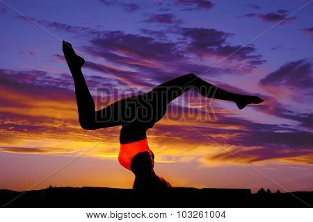 Woman Pink Sports Bra Side On Head Legs Up Out Silhouette