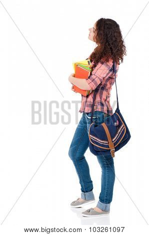 Beautiful student girl with bag and books, isolated on white background