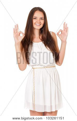 Portrait of a emotional beautiful teenage girl showing ok. Isolated on white background.