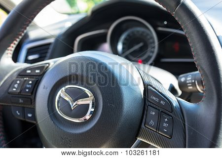 POLAND - AUGUST 9, 2015: Interior of new Mazda 3 captured with low depth of field technique. Mazda 3 is a popular compact car manufactured in Japan by the Mazda Motor Corporation.