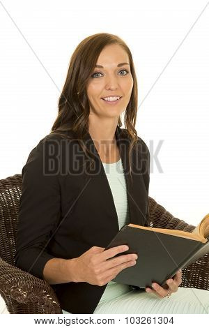 Woman Black Jacket In Chair With Book Look Smiling