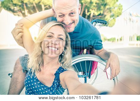 Happy Couple In Love Taking Selfie In Urban City Background - Disability Positive Concept