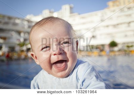 Portrait of a cute baby laughing outdoors
