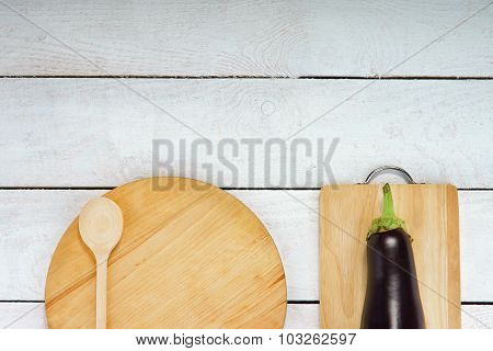 Marrow, wooden cutting boards and spoon on the table